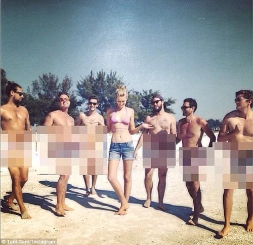 Model who's dating Leonardo DiCaprio poses on local SRQ beaches!
